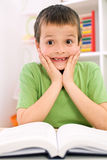 Little boy forgot reading - back to school concept stock photography