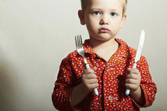 Little Boy with Fork and Knife.Want to eat Stock Photo