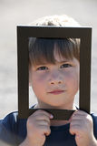 Little boy in a frame stock photography
