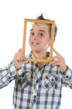 Little boy with a frame in his hands Stock Photography