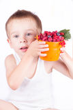 Little boy with Fresh berries. Isolated on white Royalty Free Stock Photo