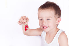 Little boy with Fresh berries Royalty Free Stock Images