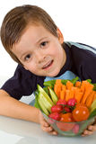 Little boy with fresh vegetables Royalty Free Stock Images