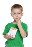 Little boy with fries Stock Images
