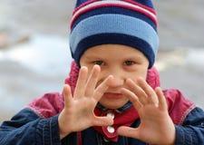 Little boy frightening or hypnotizing. Outdoor Stock Image