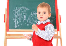 Little boy in front of chalkboard Stock Photo