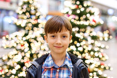 Little boy in front of christmas tree Royalty Free Stock Image