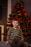 Little boy in front of christmas tree Stock Image