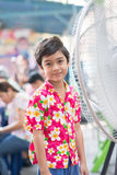 Little boy in front of electric fan in the summer  time Stock Images