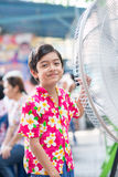 Little boy in front of electric fan in the summer  time Royalty Free Stock Photo