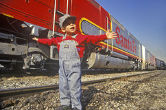 Little boy  in front of train station Royalty Free Stock Image