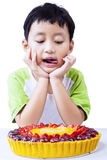 Little boy with fruit cake on white Royalty Free Stock Photos
