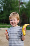 Little boy with fruits Royalty Free Stock Images