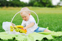 Little boy with fruits Royalty Free Stock Photography