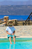 Little boy fun by the pool Stock Photography