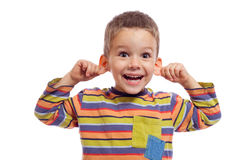 Little boy with funny face. Pulling himself on the ears, isolated on white Stock Images