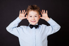 Little boy with funny face Stock Photos