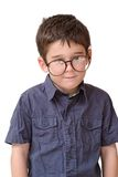 Little boy in funny round spectacles stands isolat Royalty Free Stock Photo