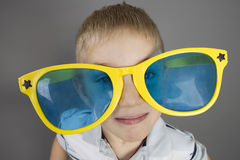 Little boy with funny sunglasses Stock Photo