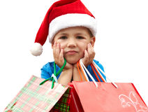 Little boy in fur-cap with shopping bags. Christmas. Little boy in fur-cap with shopping bags. Isolated over white background. Christmas Stock Photography