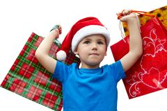Little boy in fur-cap with shopping bags. Christmas. Little boy in fur-cap with shopping bags. Isolated over white background. Christmas Royalty Free Stock Image