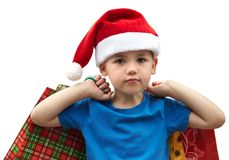 Little boy in fur-cap with shopping bags. Christmas. Little boy in fur-cap with shopping bags. Isolated over white background. Christmas Royalty Free Stock Images