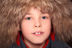 Little boy in fur hood, looking at camera Royalty Free Stock Photography