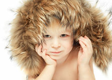 Little boy in a furry hood Royalty Free Stock Photography