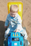 Little boy in game car Stock Images