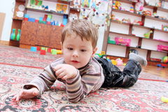 Little Boy in Game Room Stock Images