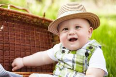 Little boy in the garden. Playing with picnic basket. Royalty Free Stock Photos