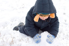 Little boy gathering up snow Stock Photography