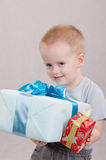Little boy gave gifts Royalty Free Stock Photos