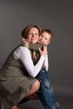 Little boy gently embrace pregnant mother Royalty Free Stock Image