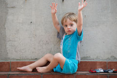 LIttle boy gesturing in the backyard Stock Photography