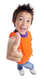 Little boy gesturing thumbs up sign. Portrait of a smilling cute little boy gesturing thumbs up sign against white background Stock Photo