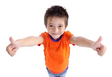 Little boy gesturing thumbs up sign. Portrait of a smilling cute little boy gesturing thumbs up sign against white background Stock Image