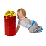A little boy gets a big gift in red box Royalty Free Stock Photo