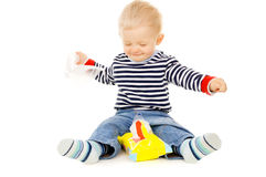 The little boy gets the wet wipes, and is played. On white background Royalty Free Stock Photo