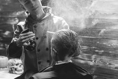 Little Boy Getting Haircut By Barber Royalty Free Stock Images