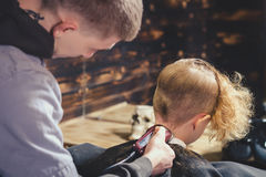 Little Boy Getting Haircut By Barber Stock Photo