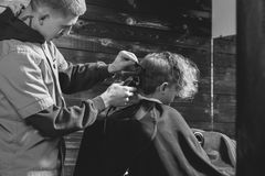 Little Boy Getting Haircut By Barber Royalty Free Stock Photography