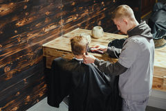 Little Boy Getting Haircut By Barber Royalty Free Stock Image