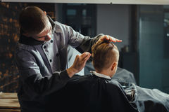 Little Boy Getting Haircut By Barber Royalty Free Stock Photo