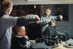 Little Boy Getting Haircut By Barber Stock Photography