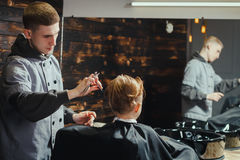 Little Boy Getting Haircut By Barber Stock Images