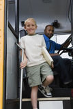 Little Boy Getting Off School Bus Stock Photography