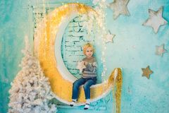 Little boy getting ready for the holiday. Happy New Year and Merry Christmas stock images