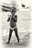 Little boy from Ghana with a stick in his mouth Stock Images