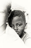 A little boy from Ghana watches on the camera Stock Photography